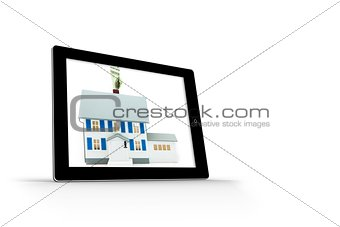 House with price tag on tablet screen