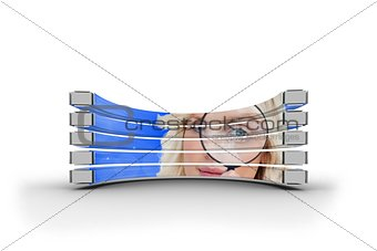 Blonde with magnifying glass on abstract screen