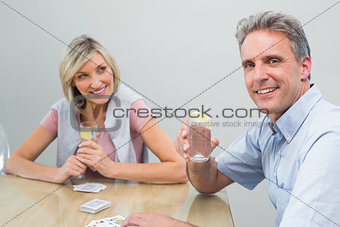 Couple with lime juices while playing cards at home