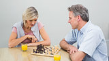 Concentrated couple playing chess