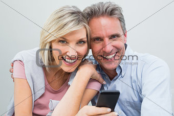 Cheerful couple with mobile phone