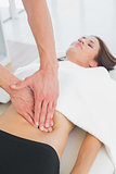 Close-up of a physiotherapist massaging woman's body