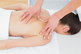 Physiotherapist massaging woman's back