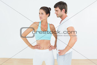 Fit couple in the fitness studio