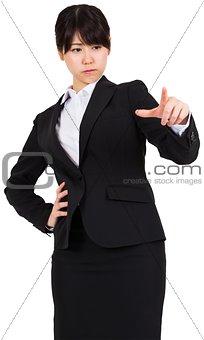 Focused businesswoman pointing