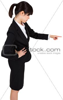 Focused businesswoman pointing