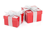 Two red gift boxes with silver ribbon and bow