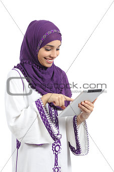 Arab woman reading and touching a tablet reader