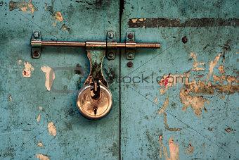 Padlock on turquoise background