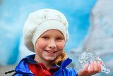 Girl with ice piece near Nigardsbreen glacier (Norway)