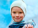 Boy with ice piece near Nigardsbreen glacier (Norway)