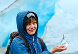 Woman with ice piece near Nigardsbreen glacier (Norway)