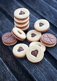 Heart shaped cut out cookies with chocolate filling