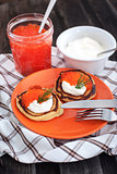 Pancakes with red caviar and sour cream