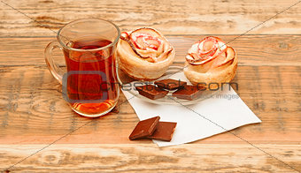 Apple cakes with cup of tea like flower on wooden table