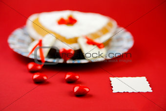 Cake wihh little hearts onthe red background
