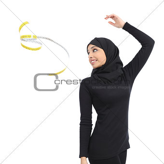 Arab saudi fitness woman throwing a measure tape
