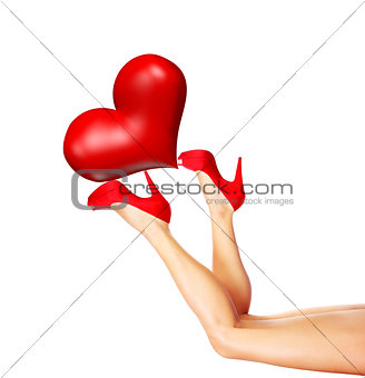 Beautiful female legs holding heart