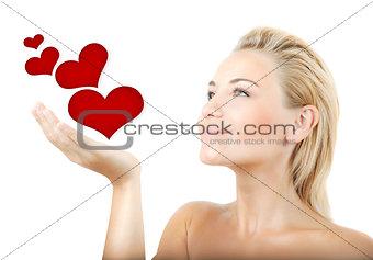 Beautiful woman holding hearts