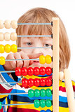 Child Counting on Colorful Wooden Abacus