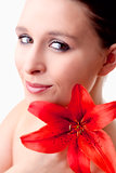 Portrait of a Beautiful Young Woman with Red Lily