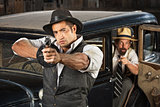 1920s Era Gangsters with Guns and Car
