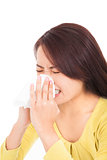 young woman is sneezing with painful face