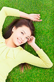 young woman lying in the park meadow