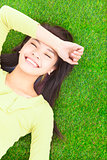 High angle view of a young woman resting on grass
