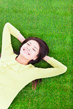 smiling woman lying on the grassland