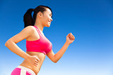 Runner woman jogging in sunny day