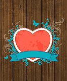 Wooden background with red heart