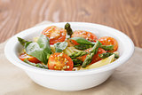 simple italian pasta penne with tomatoes and basil