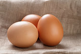 brown eggs  on burlap or sack cloth