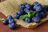 fresh organic ripe blueberries on a wooden table