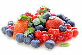 various berries - strawberry, currant, blueberry on white background
