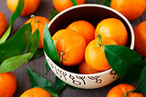 Tangerines on wooden background
