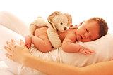 one cute little newborn baby lying on his mom
