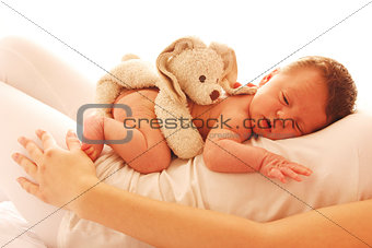 one cute little newborn baby lying on his mom