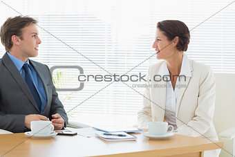 Smartly dressed couple in a business meeting