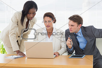 Business colleagues with laptop in a meeting