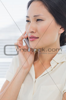Beautiful young businesswoman using cellphone