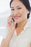 Beautiful businesswoman using cellphone