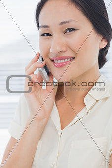 Beautiful businesswoman using cellphone