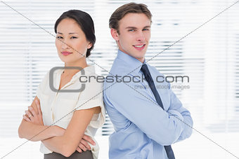 Business colleagues standing with arms crossed