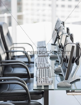 Chairs, computers and headset in modern office