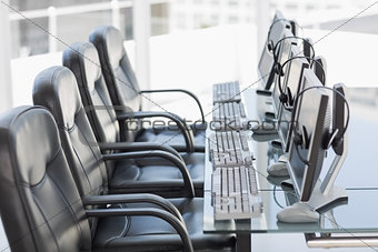 Chairs, computers and headset in a modern office