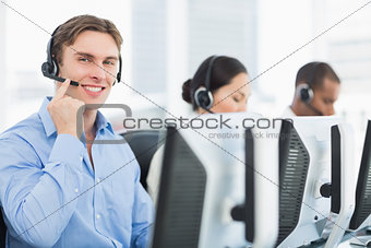 Business colleagues with headsets using computers