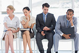 Four business people waiting for job interview