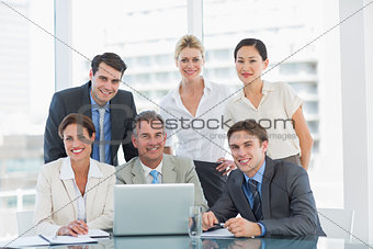 Business colleagues with laptop at office desk